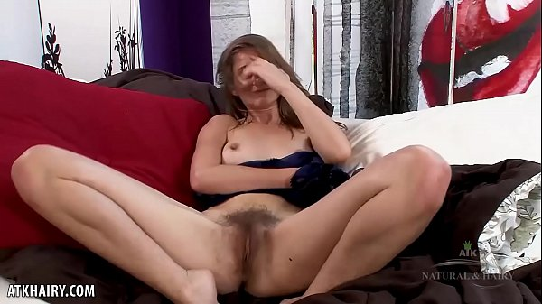 Girl next door Kitten Coyote plays with hairy pussy