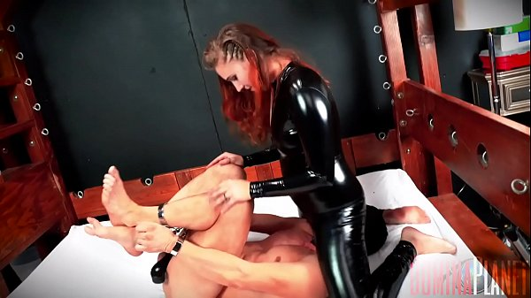 Fuck Face - Stephie Staar has a slave hog tied and helpless. She unzips Her crotch and starts riding his face HARD, bouncing up and down and smothering him for Her pleasure.