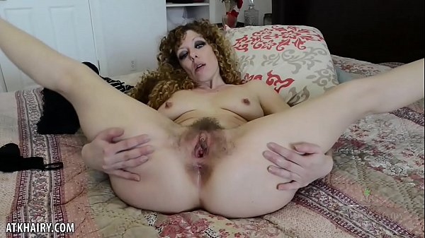 Leona strokes her hairy pussy for you