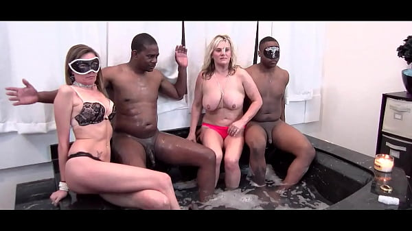 Blonde MILFs giving blowjob in jacuzzi foursome Thumb