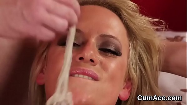Horny doll gets cum shot on her face swallowing...