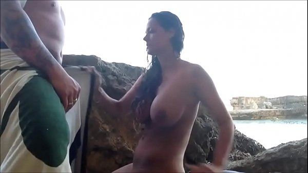 Couple making love by the sea