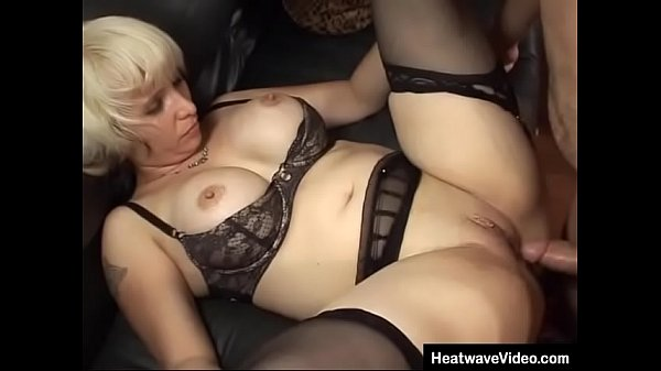 Teacher with large fake tits fucked by her young student