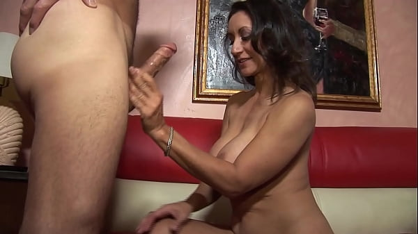 Brunette milf gives a blowjob swallows the cum  thumbnail