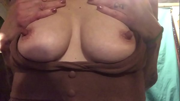Sexy mature bounces her perky tits