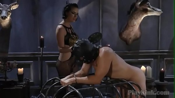 Brunette dominatrix playing around with her slave Thumb