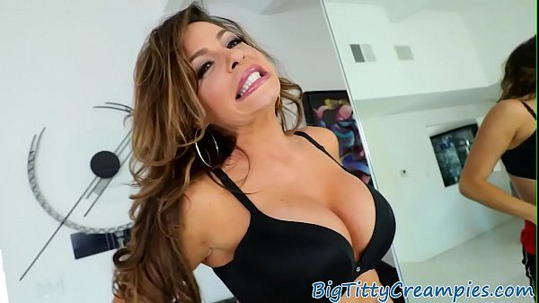 Busty milf tittyfucks throbbing cock