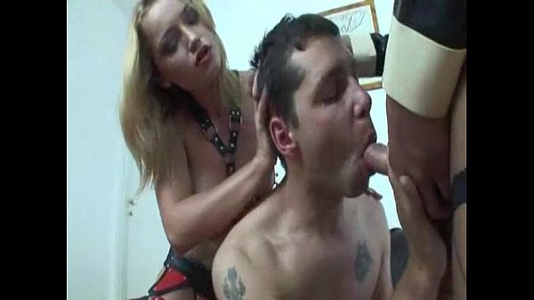 Hot Latex Shemale Camilla and a Girl dominating a Guy