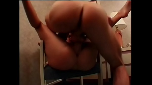 Young brunette moans with pleasure while getting banged on a chair