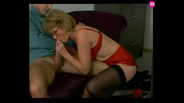 Mature Secretary Pleases in Red Satin & Stockings Thumb