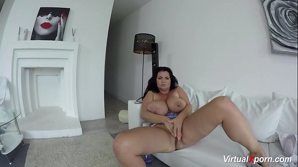 Busty Reny shows her gigantic boobs at the camera