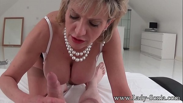 Busty British mature Lady Sonia sucking a cock ...