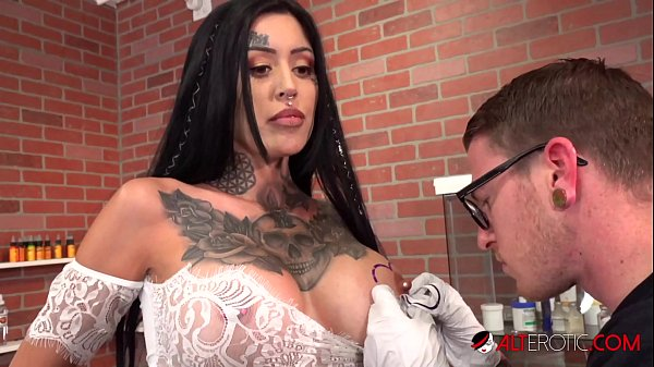 Beautiful babe Janey Doe has her big boob tattooed