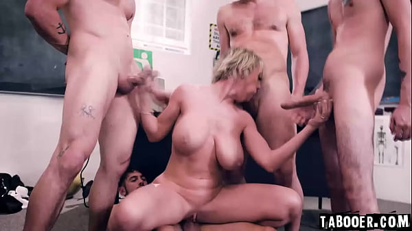 50 years old teacher Dee William put herself at odds with four of her students during a class and ends up being gangbanged by her students!