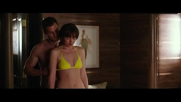 DAKOTA JOHNSON breasts bikini scene in Fifty Shades Freed