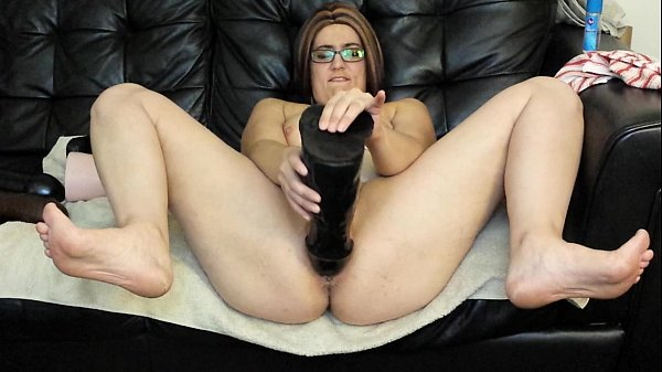 Milf fucks pussy with huge dildos