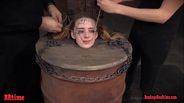 Bdsm babe trapped in a barrel and electrified