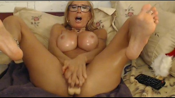 MILF With Fake Tits Uses Her Dildo On Webcam