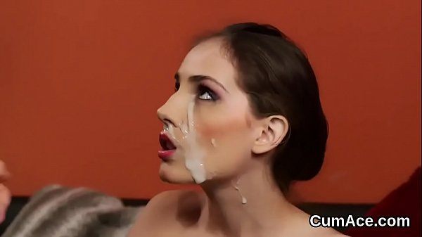 Unusual centerfold gets sperm load on her face sucking all the jizz