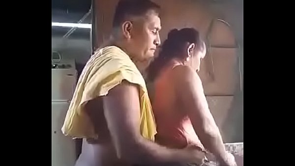 Horny old couple in kitchen