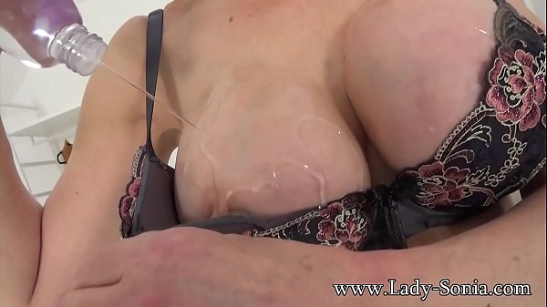 British MILF Sonia oils her big tits and plays