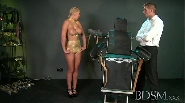 BDSM XXX Master straps big tits submissive girl to a gyno chair