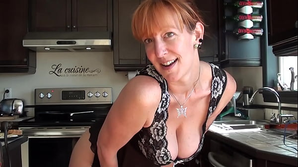 Cute redhead milf cooking and teasing us