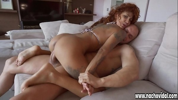 Venus Aphrodite shows big tits, delicious legs and tanned skin with many tattoos. She masturbates her pussy for Nacho Vidal, who pushes his huge cock in her cleavage