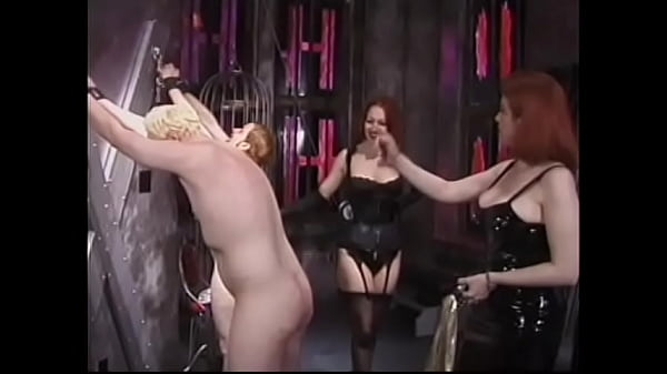 Two red-haired mistresses tie their slaves to the crosses and severely punish them with a whip