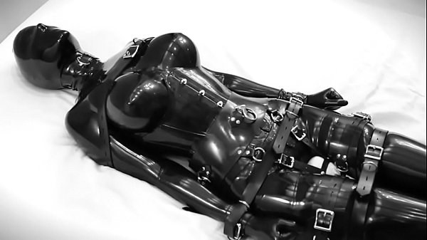 Rubber doll masturbates, then is bound and vibrate