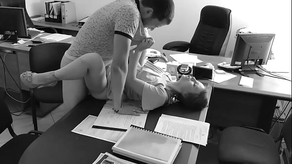 The boss fucks his tiny secretary on the office table and films it on hidden camera