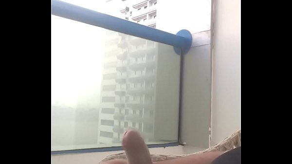 Cumshot on the balcony ... what a thrill ... in public view ... got caught