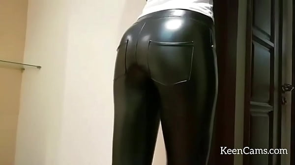 Leather Girl in tight pants and high heels