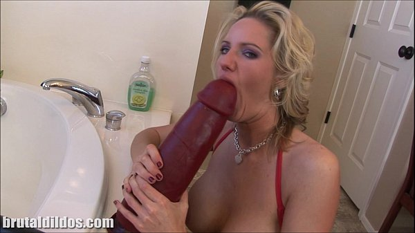 Busty blonde milf Zoe fills her pussy with a huge dildo