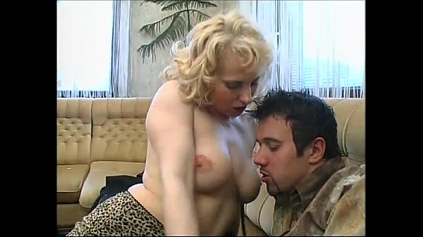 Sexy blonde in black boots seduces a distracted...