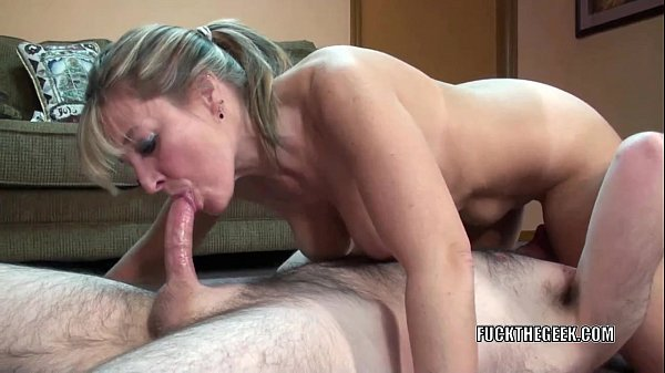 Mature swinger Liisa shows her big tits while s...