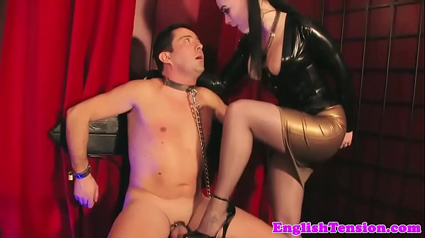 Glam british dominatrix trampling subs cock