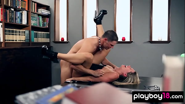 Amateur blonde babe Nicole in glasses serving a big cock in the library Thumb