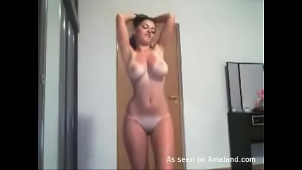 Latina chick strips and dances in front of her webcam Thumb
