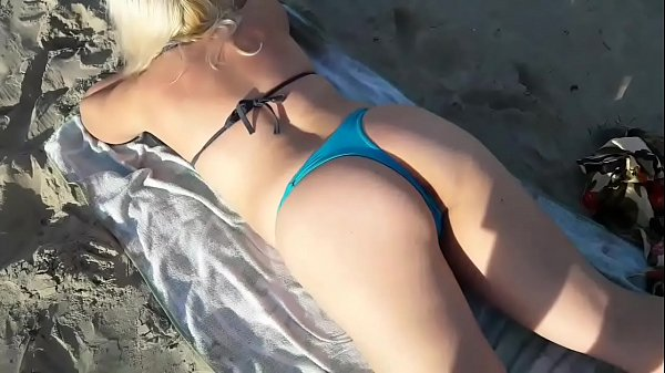 Hot blonde fucking on the beach