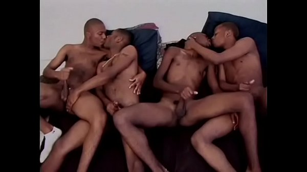 Two gay young couples fuck on the sofa side by side