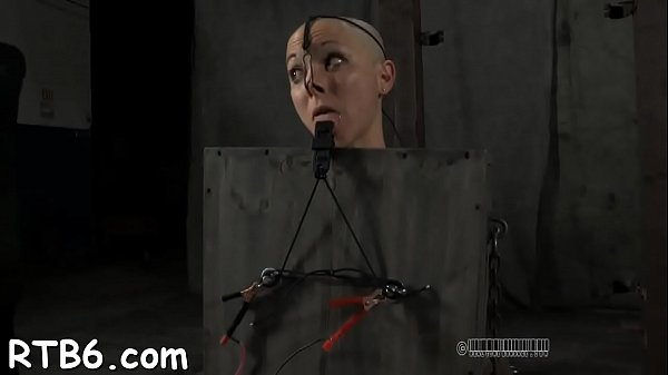 Agreeable slaves are made to strip inside a small cage