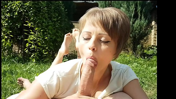 Pretty milf sucks him off with showing her little sexy soles in the yard
