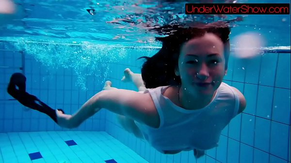 Perfect shaved teen in the pool