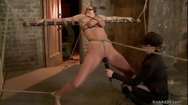 Blonde slave is tied and stretched