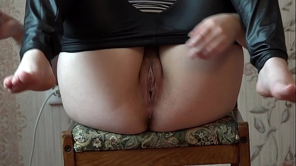 Brunette lowers the leggings and with a large d...