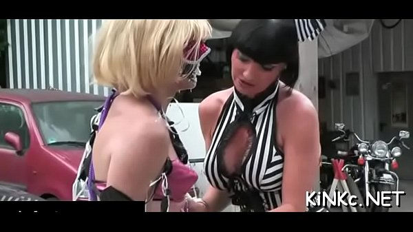 Two pliant slaves of naughty mistress in latex