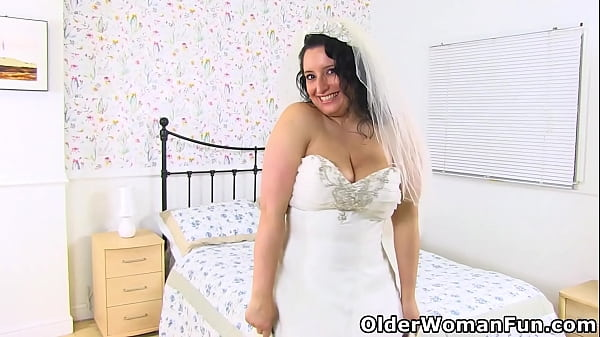 Here comes the bride and she sticks her finger up her craving cunt