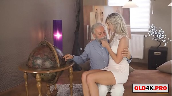grandpa shows the world to the cute blonde girl Thumb