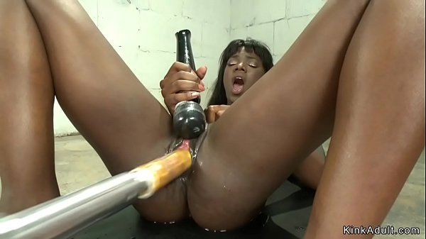 Ebony squirter fucks machines Thumb